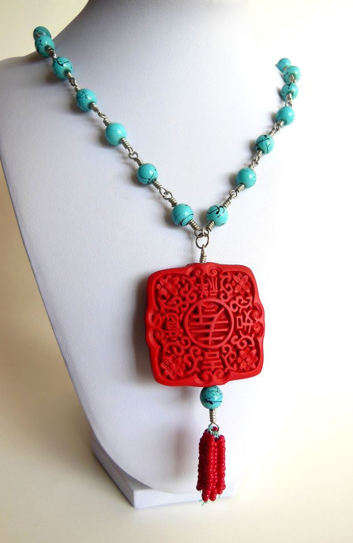 Made using silver-colored craft wire, this necklace features a large, red focal bead (feels like it's made from clay), #zibbet