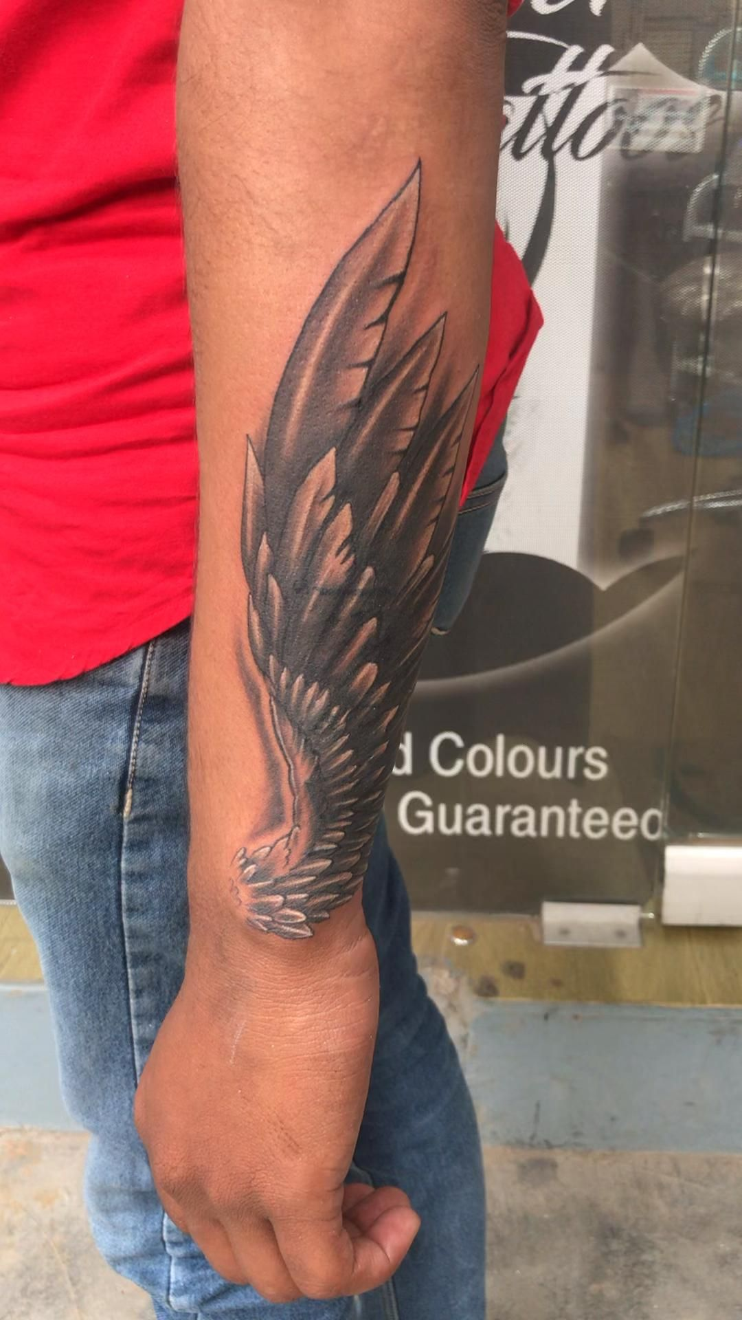 Wings coverup tattoo