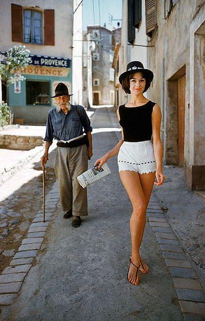 Irène Gindry in white shorts walking down a narrow street in St. Tropez,  photo by Mark Shaw, 1961 79c650f4c5