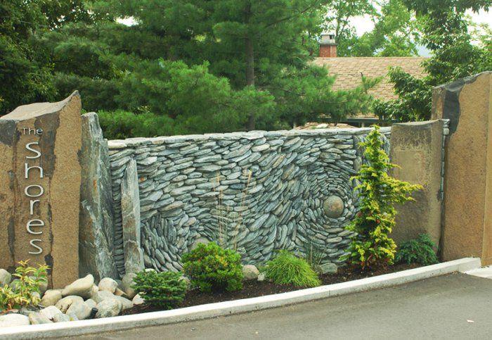 Artist Couple Creates Gorgeous Stone Wall Art Installations