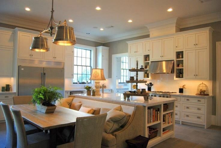 If tight on room, combine kitchen island with dining table.