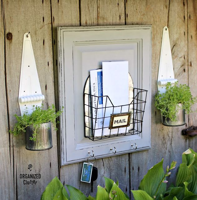 Photo of Garage Sale Wire Bin/Cabinet Door Up-cycled As A Mail Organizer