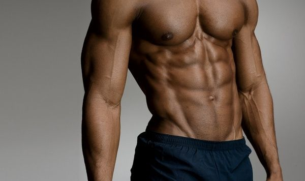 Caucasian Fitness Model In Gym Close Up Abs Stock Photo