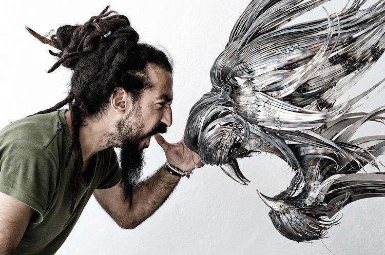 While talented artist, Selçuk Yilmaz, works with an array of different materials, he's especially partial to metal. And that's probably because he's damn good with it.Just take his most recent works for example - a series of ornately hand-crafted animal masks of a tiger, a red fox, and a lynx, all made from a variety of hand-hammered and welded metals, all insanely awesome.