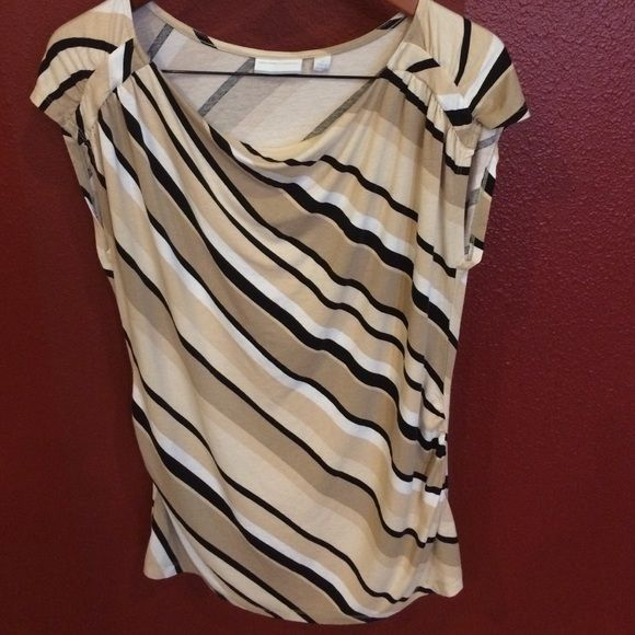 Great top! GUC cap sleeves, shirred side (hard to see but I took pick of the side) with drape neck front. Great with skinny black pants and black heels!!! No rips, tears or stains. New York & Company Tops Tees - Short Sleeve