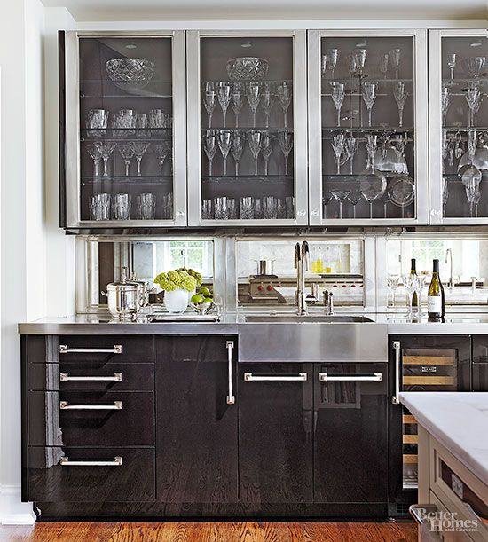 this wet bar is beautifully equipped for cocktails thanks to a wine cooler bar sink