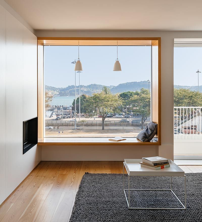 Located In The Living Room This Picture Window Has A Deep Wood Frame Creating A Window Sea Picture Windows Living Room Window Seat Design Living Room Windows