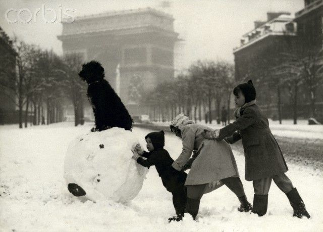 Children playing with snow in Paris
