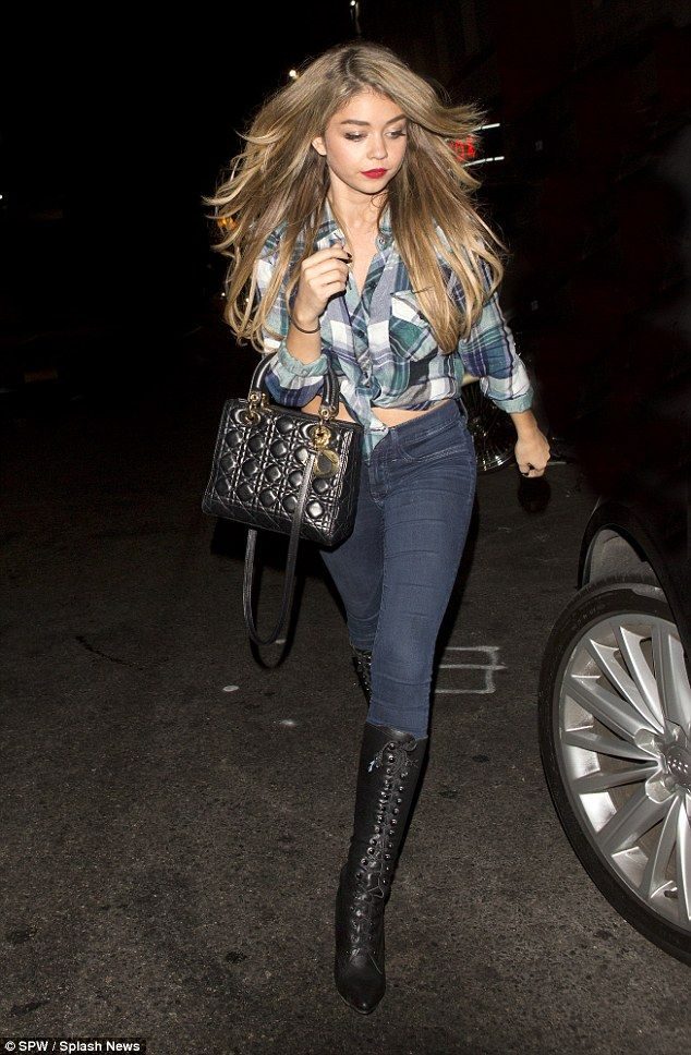 Wild west: Sarah Hyland parties at Hollywood's Warwick nightclub with friends in a plaid shirt and boots