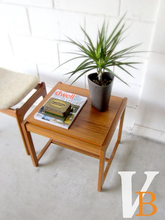 Danish Modern table converts from a wooden top to an upholstered