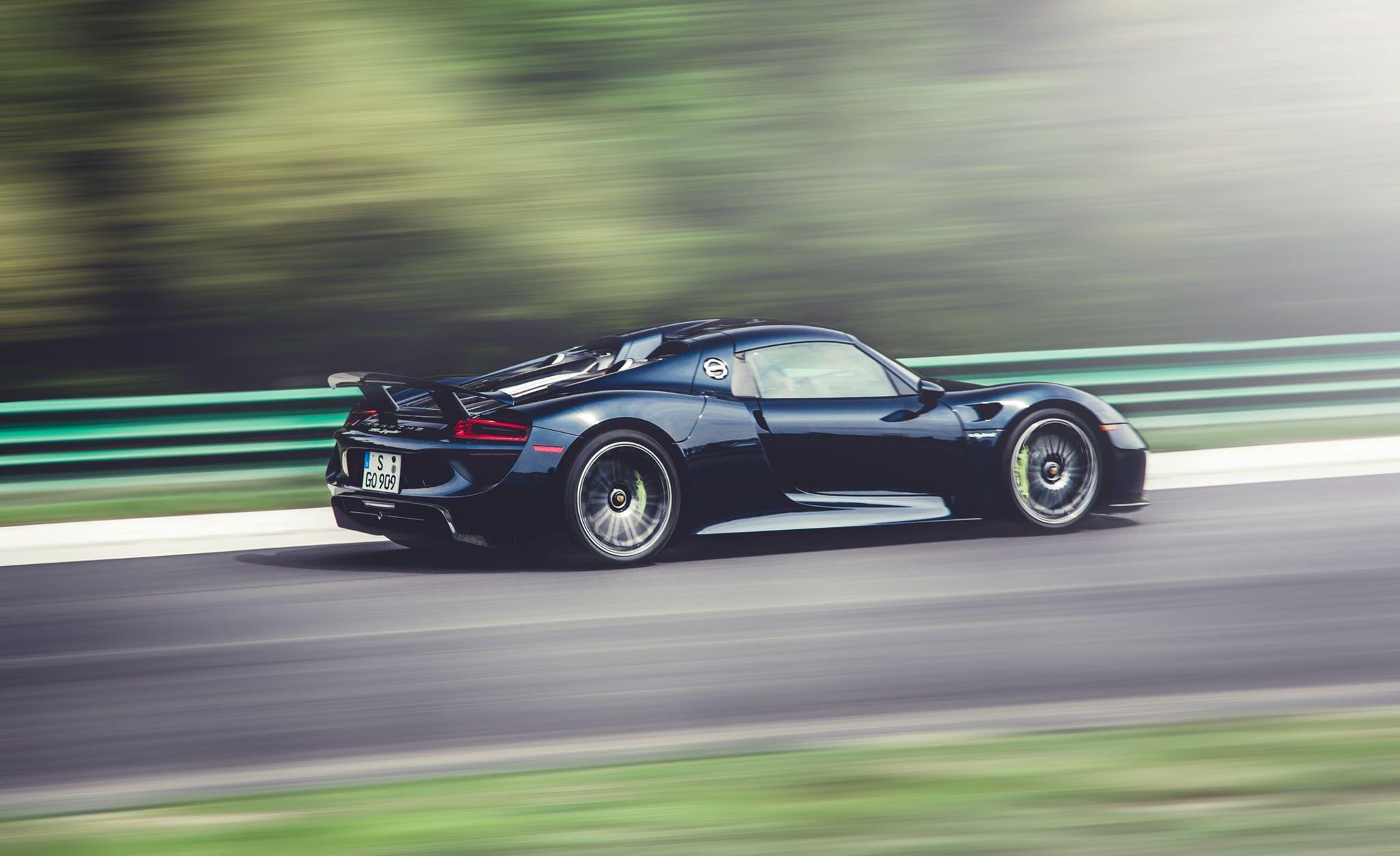 Dark Blue Porsche 918 Spyder Side Angle In Motion On Track