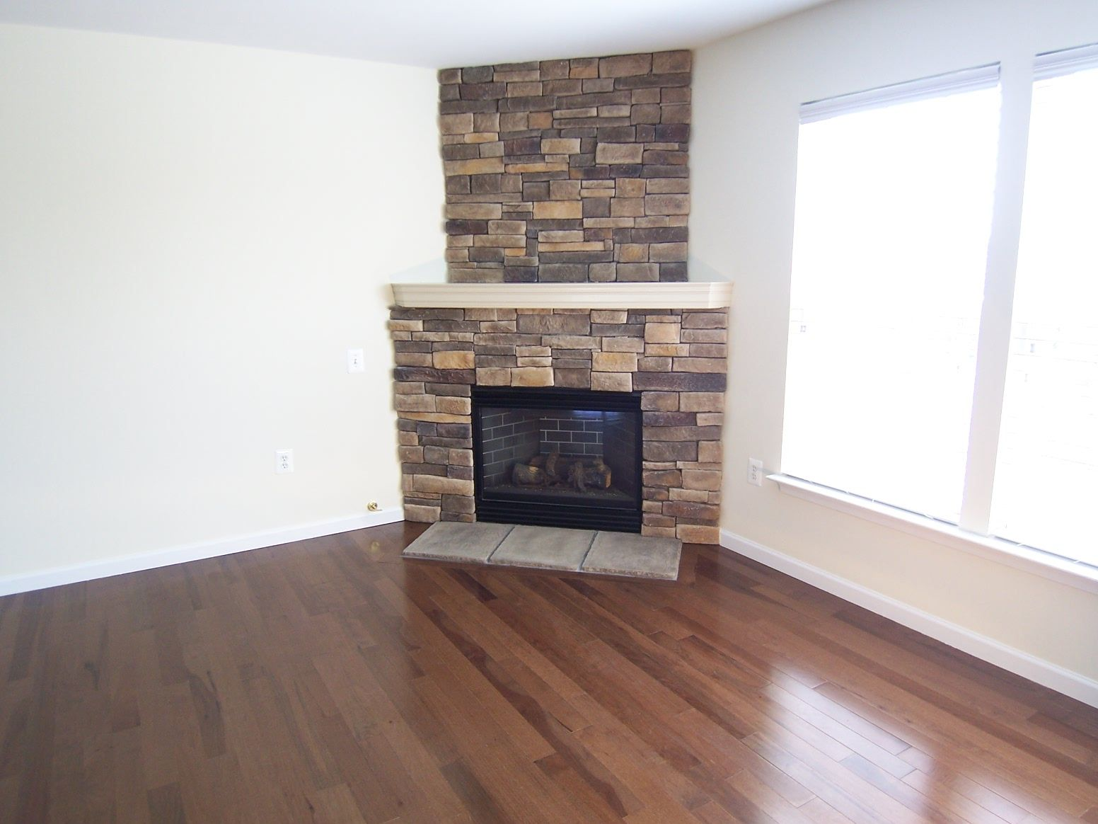 upgrade old corner gas fireplace with stone. Posted by Trina ...