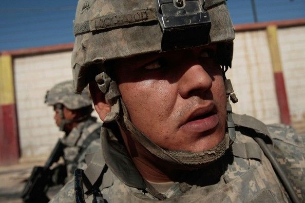 Spc. Robert Lockwood of Knoxville, Tennessee (R) and Pvt. Allan Sildora Jr. of Kapolei, Hawaii (L, both of the U.S. Army's 1st Battalion, 5t...