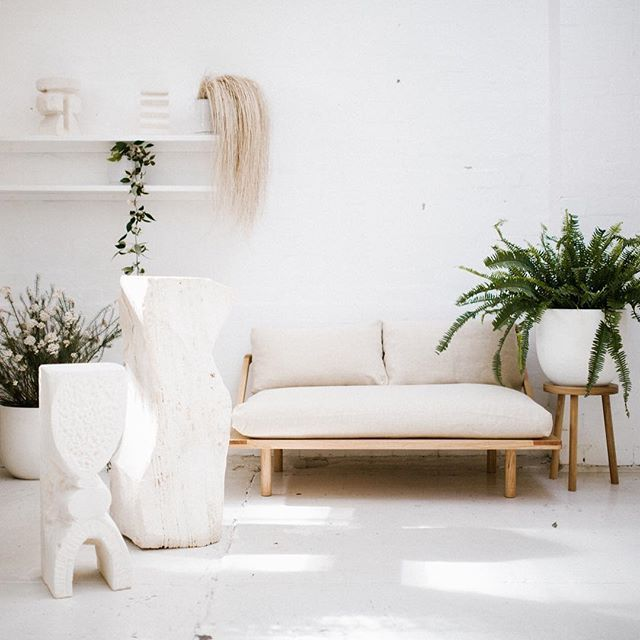 Our linen Lovers Dreamer couch hanging out with @den_holm beautiful stone sculptures. We have some select pieces of den holms available for purchase through our showroom. Photo by @jessicatremp