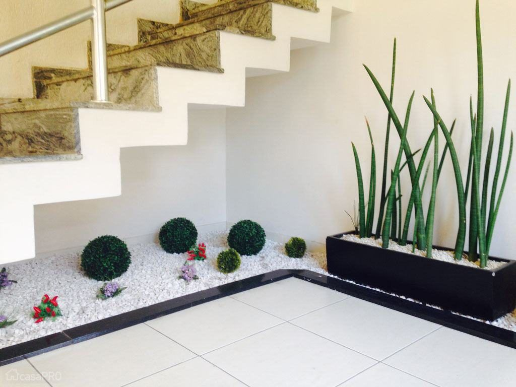 How To Make A Small Pebble Garden Under The Stairs Small Garden Under Stairs Under Stairs Space Under Stairs