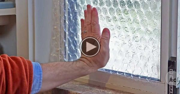 He Presses Bubble Wrap Over His Window For A MoneySaving Trick