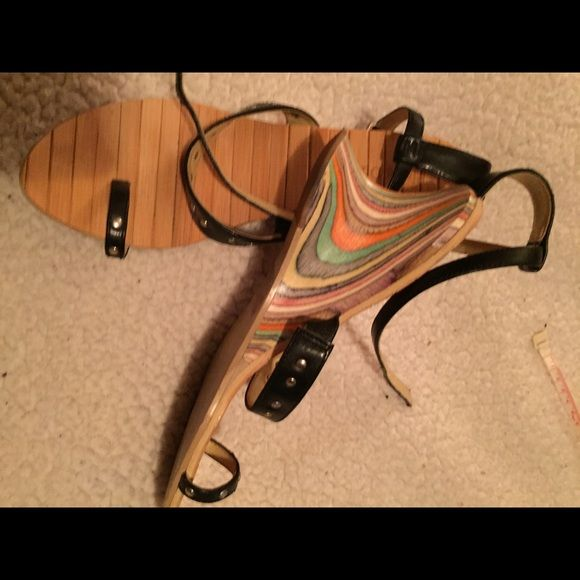 Pierre Dumas sandals  I have Never seen a pair like these. I'm a cobbler and these shoes are one of a kind. Flex bamboo footbed with color wave wood heel. Marked 5 1/2 I wear a 6 1/2 and the fit perfect. Very comfortable you will get tons of complements Pierre Dumas Shoes Sandals