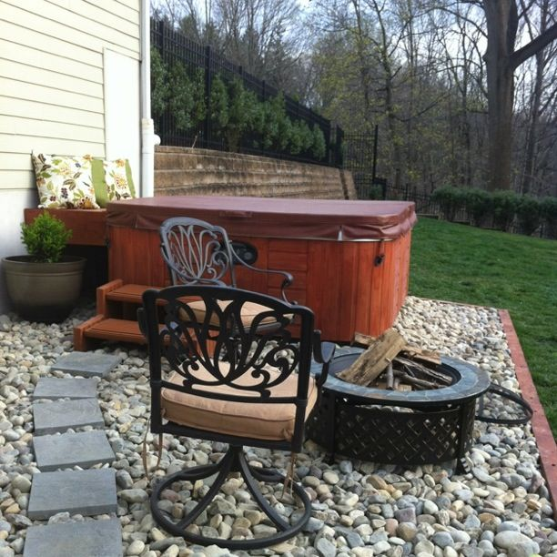 Hot tub at the bottom of deck stairs gravel backyard for Hot tub designs and layouts