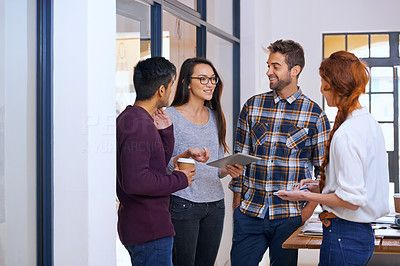 Buy stock photo Cropped shot of a group of young designers discussing work in their office