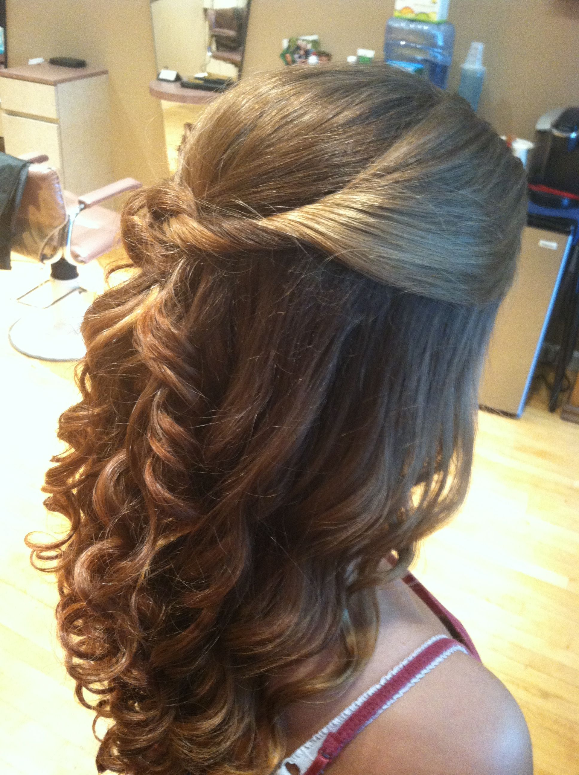 curled with a wand, knotted half up with cascading spiral