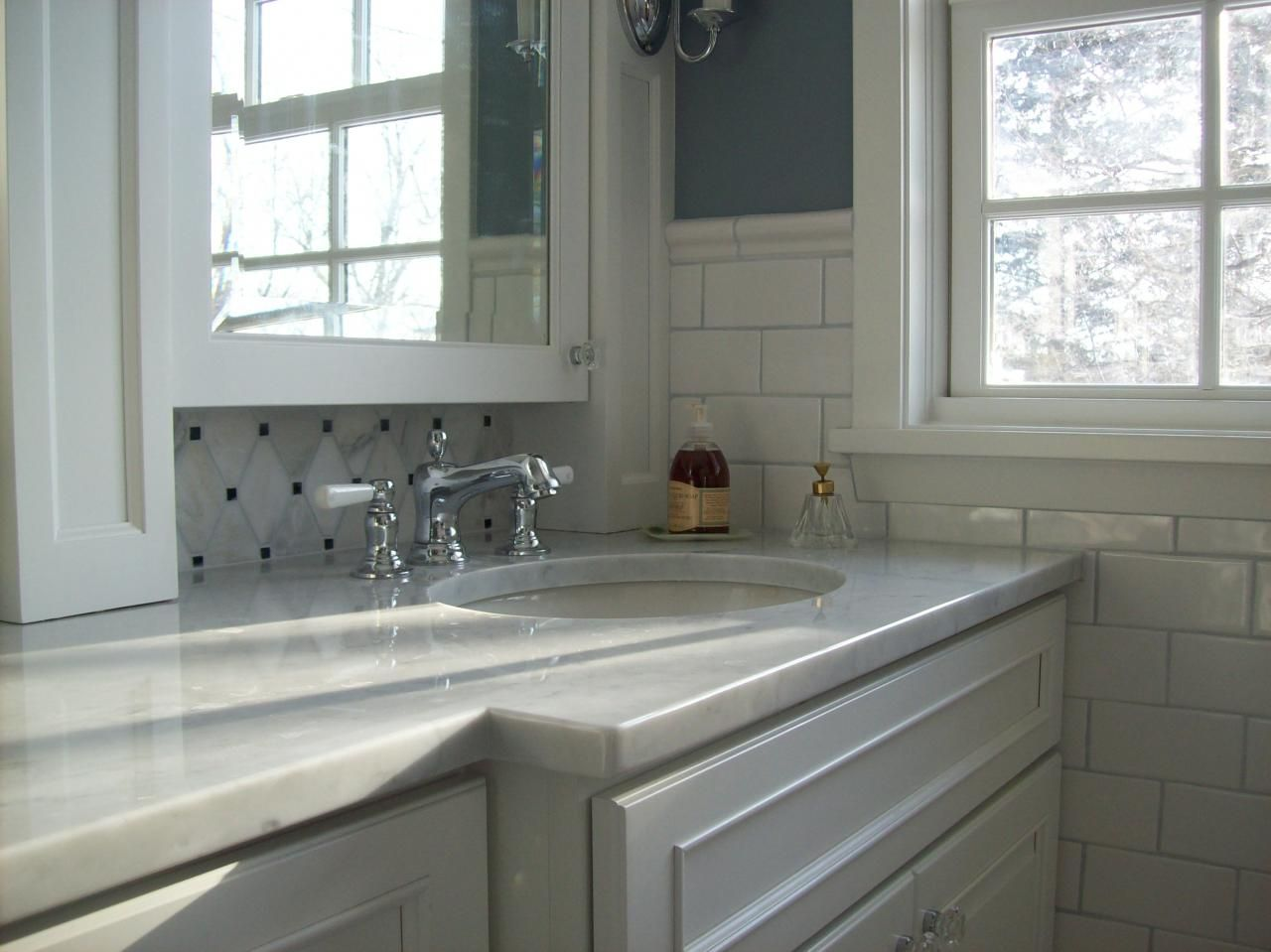This shows the ceramic tile wainscoting and the backsplash tile ...