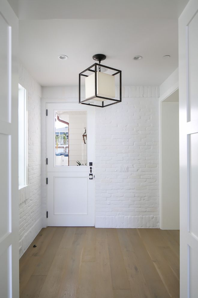 This Mudroom With Painted White Brick Is Located Just Off The Kitchen And Features A Dutch Door Gl Lighting Circa Caged Lantern