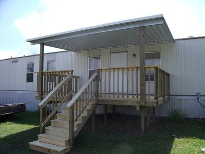 Wood deck and metal cover for mobile home mobile home for Wooden porches for mobile homes
