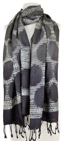 Indian artisan Aziz Khatri is a master at resist-dyeing techniques. The patterning in this silk scarf is made using a stitched resist known as shibori.
