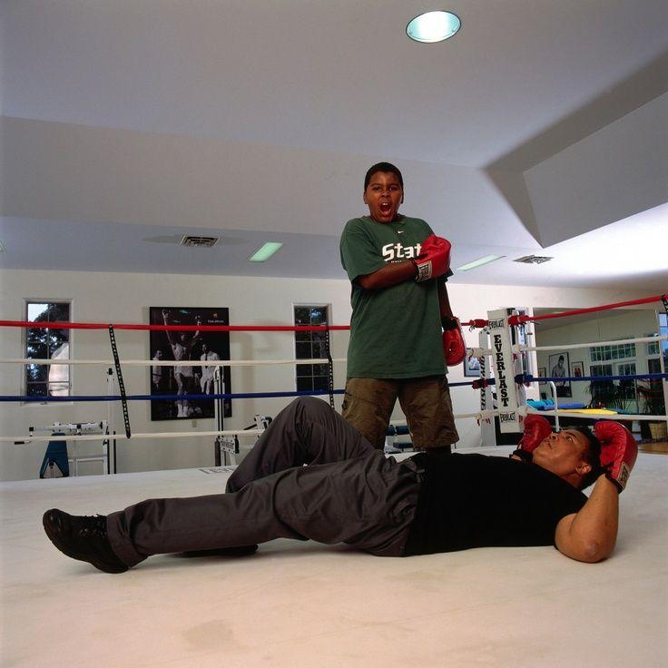 Muhammad Ali Son | champion Muhammad Ali posing on the canvas as his son Assad Amin Ali ...