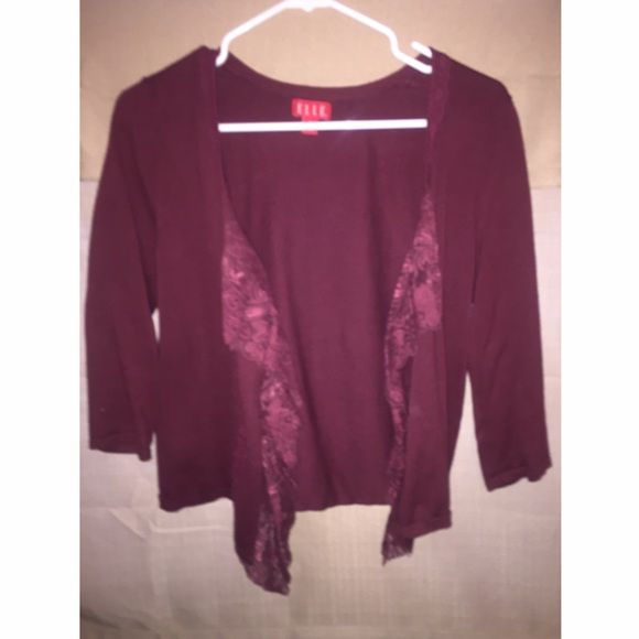 Elle 3/4 sleeve lace cardigan Maroon / red cardigan. There's no buttons. It has lace on the front. Looks very flowy. Elle Sweaters Cardigans