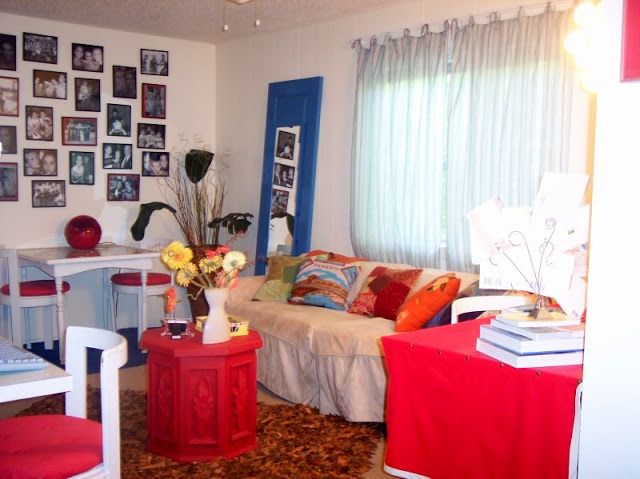 I've recently come across some fun dorm blogs… which made me reminisce about my studio apartment from college… I was thrifty and very colorful… I'm still thrifty, but I think my color palette has calmed down just a tad… The living room… my parents lovely plaid coach with a slip cover, lots of wal-mart picture …