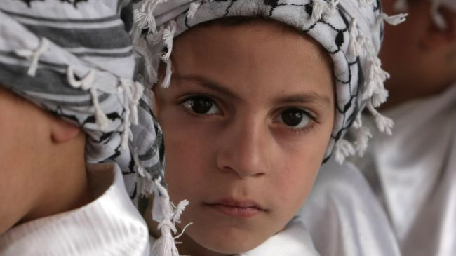 Palestinian children take part in a rally in Gaza ahead of the anniversary of the Nakba on May 9, 2012.
