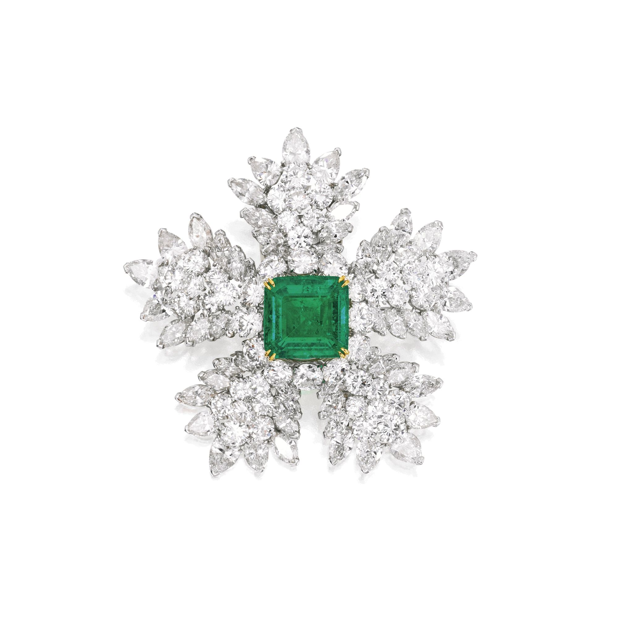 A PLATINUM, EMERALD AND DIAMOND BROOCH, VAN CLEEF & ARPELS, NEW YORK, CIRCA 1965 designed as a flowerhead set in the center with a square emerald-cut emerald weighing 9.68 carats framed by round diamonds weighing approximately 13.45 carats, further set with 15 pear and 40 marquise-shaped diamonds weighing approximately 14.20 carats, signed VCA NY, numbered 36609; with signed box.