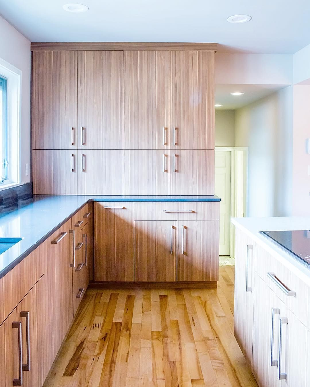 We Used Two Different Cabinets In This Kitchen Arizona Cypress And Walnut For A Contemporary Feel Th In 2020 Blue Painted Cabinets Staining Cabinets Kitchen Projects