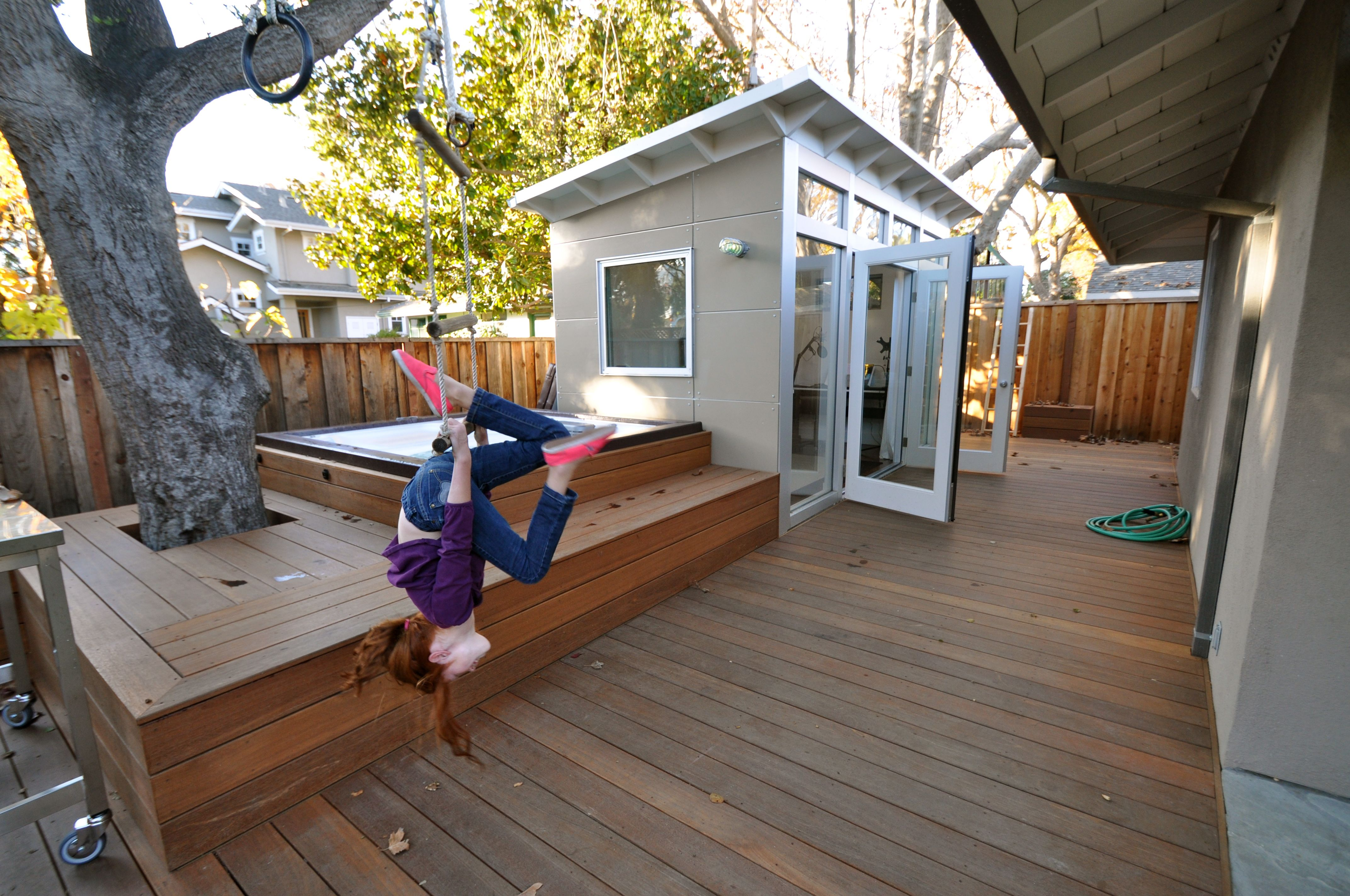 Kids play both inside and around the for Backyard guest room