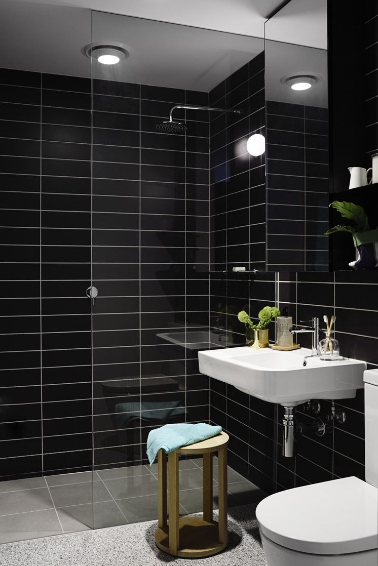 Tiled Black Bathroom With Gold Stool