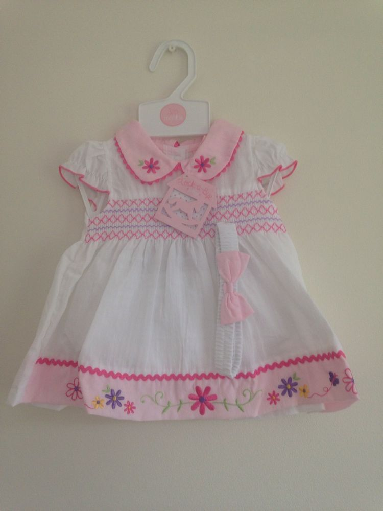 67a0ee7cd93f Baby Girls White   Pink Appliqué Smocked Spanish Style Dress.0-3 ...
