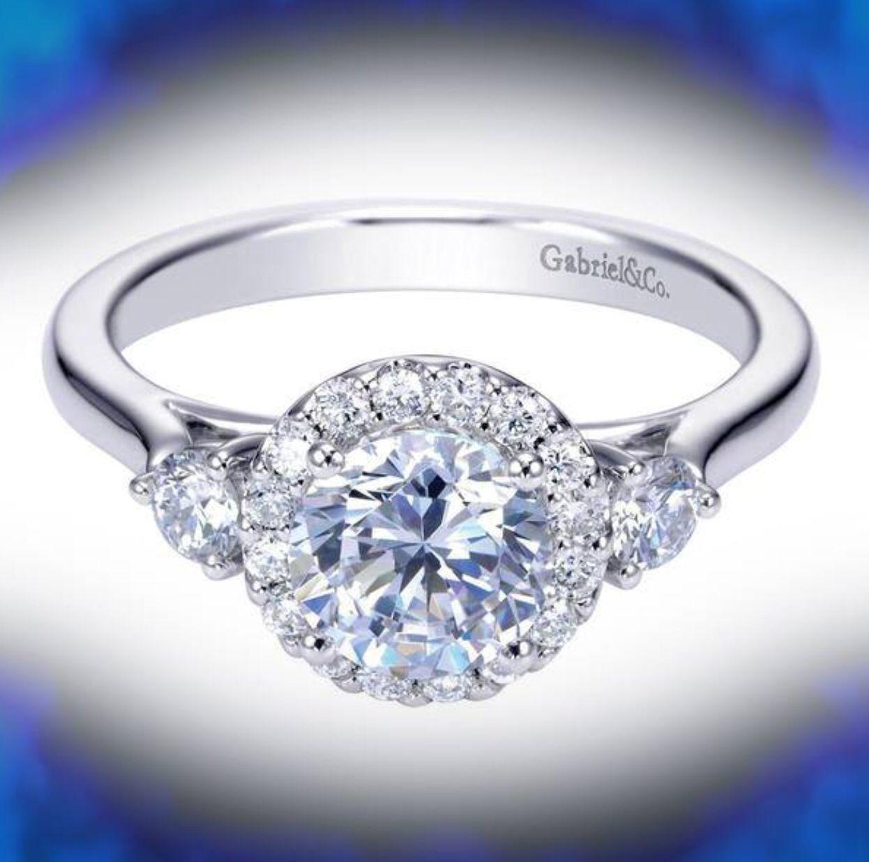Simply Spectacular...  White gold halo diamond ring #ring#whitegold#diamond#engagementring##haloring#platinum#gabrielny#ajkleinjewelers.  203-292-3300
