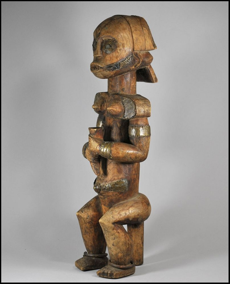 """Fang Reliquary Figure  Tribe: Fang Country: Gabon Material: Wood, Metal Size: 23.75"""" (60.33) Tall."""