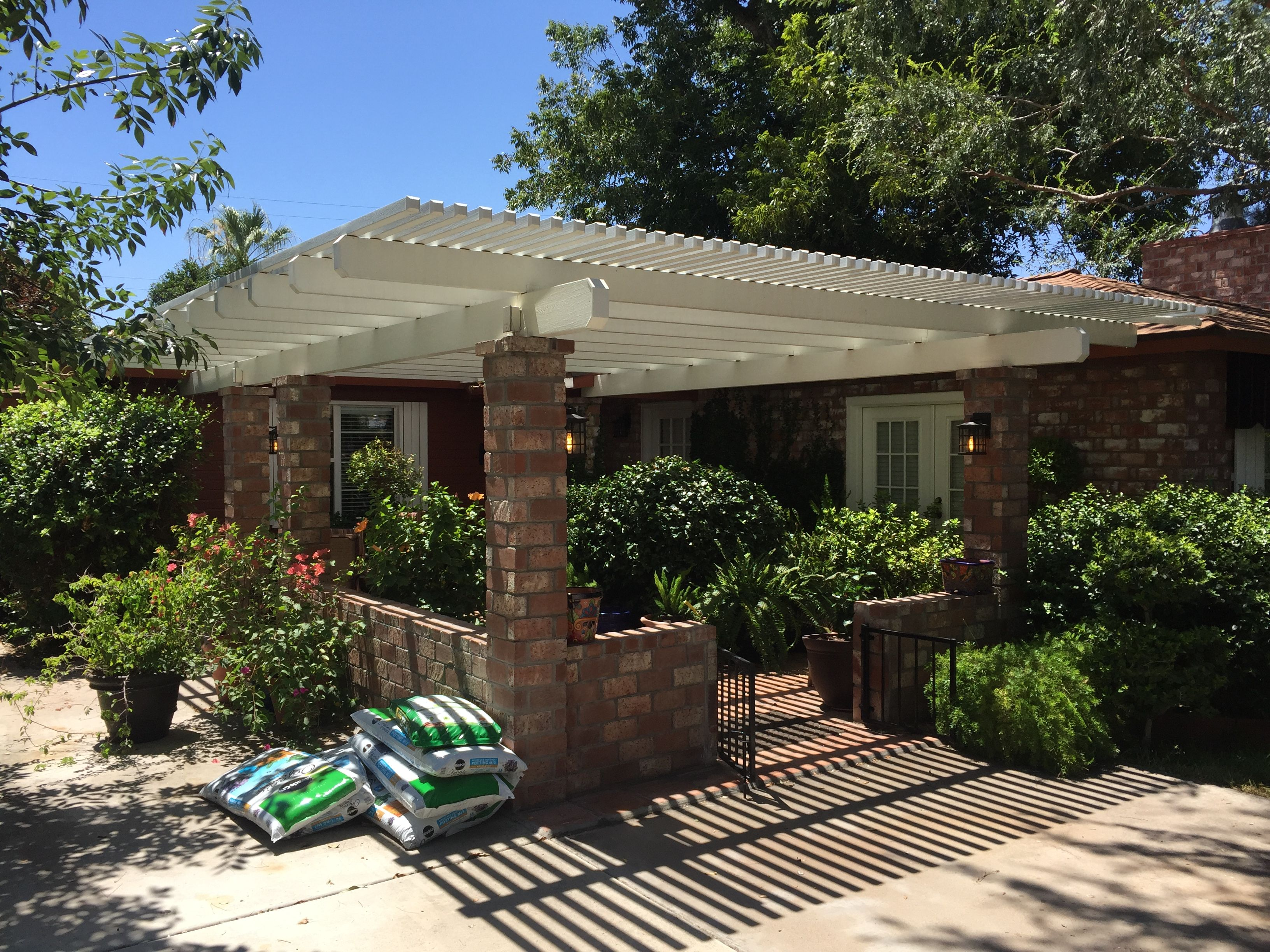 lattice patio cover provides filtered sunlight patio covers