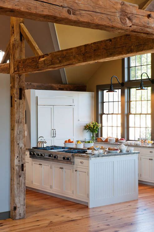 Rustic Cottage Kitchen With Cathedral Ceilings Accentuated