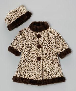 Little girls will welcome a chill in the air if it means dressing up in this graceful three quarter sleeve coat and matching beret. Timeless style and cozy warmth take it from the playground to a fancy day on the town with family.