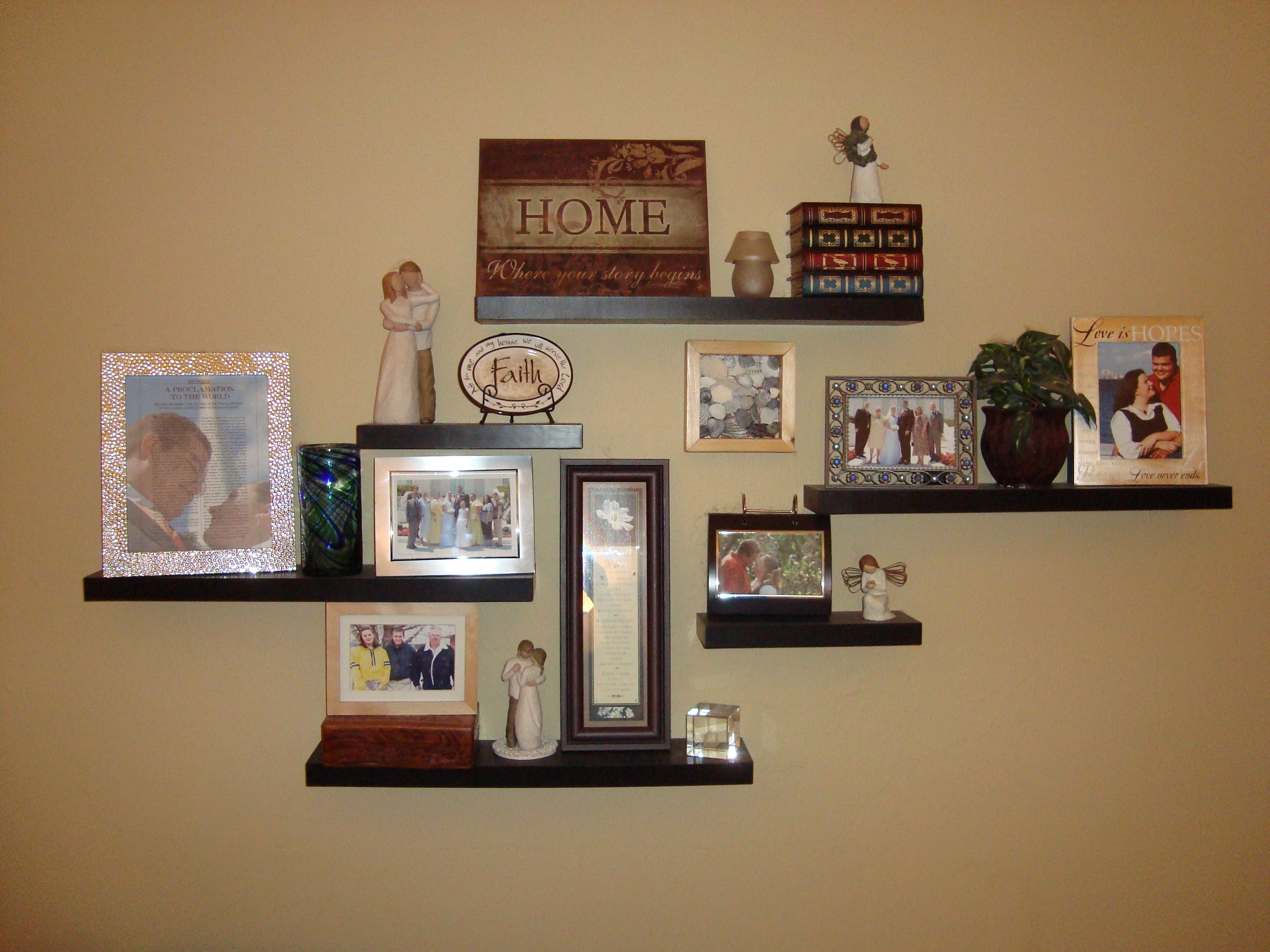 We made this 3-D wall collage with floating shelves from Target ...