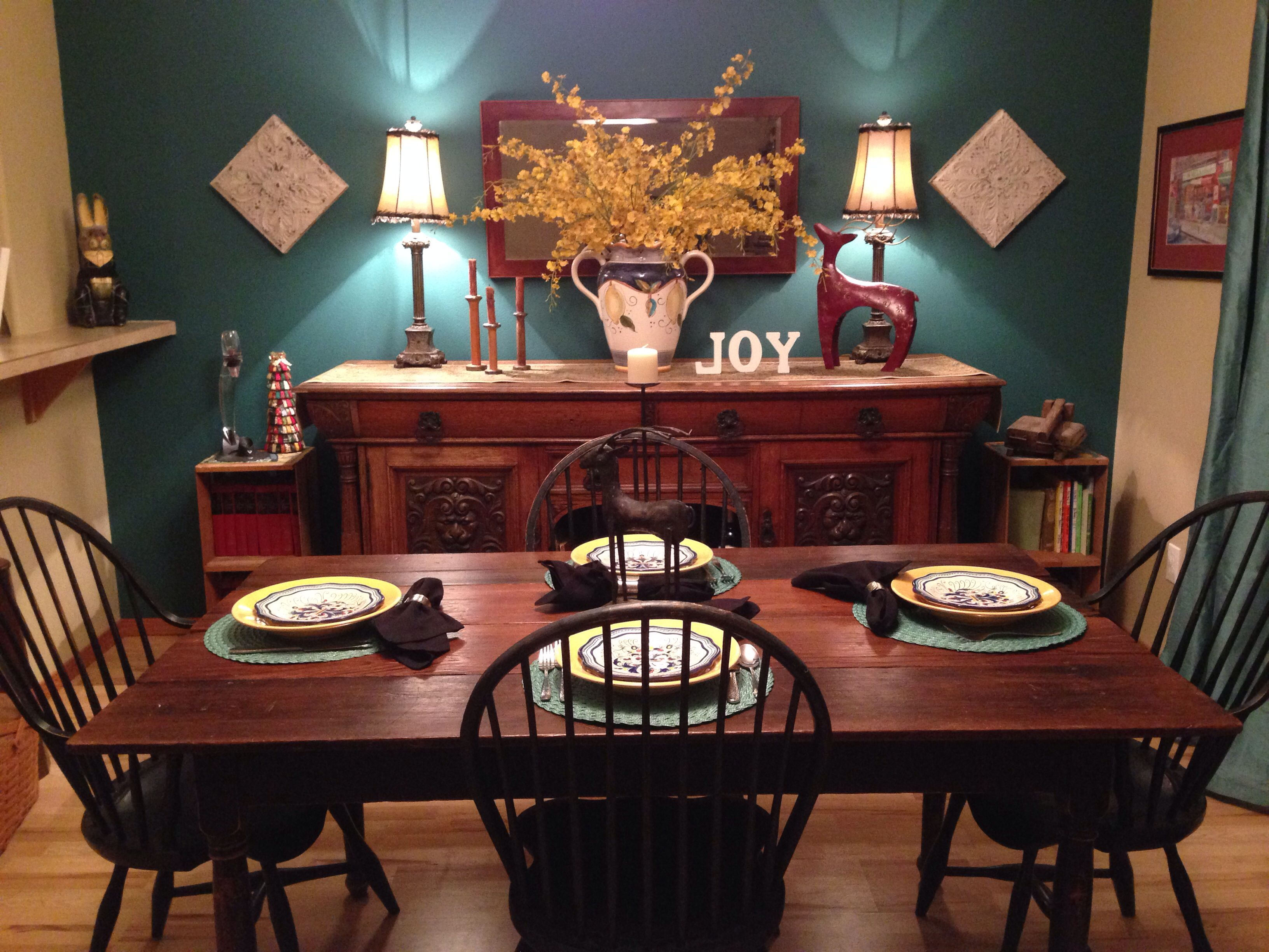 This Teal Accent Wall With Drapes Mixed Chocolate Wood Furniture Makes Dinner