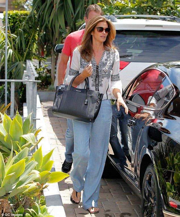 Timeless beauty Cindy Crawford, 49, is doted on by husband