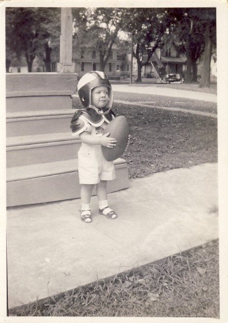 Toddler Football Player With Shoulder Pads Helmet And Ball Photo