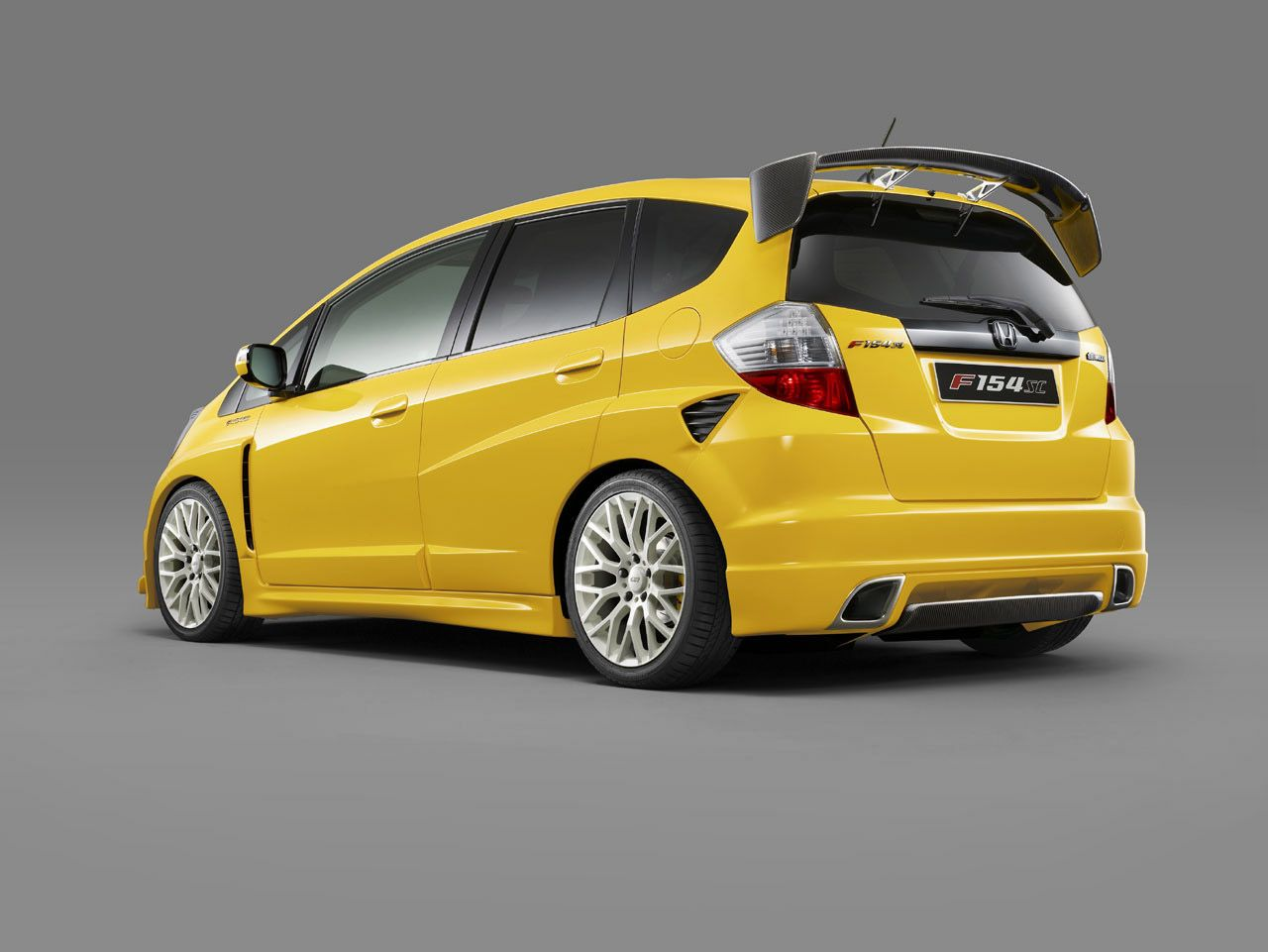 Honda jazz yellow rear back automotive pictures wallpapers