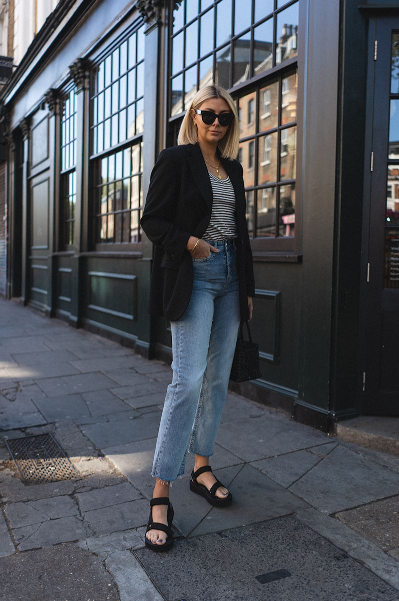 Emma Hill Style Black Blazer Stripe Vest Raw Hem Might Wash Jeans Teva Dad Sandals Woven Leather Bag Chic Outfits Spring Teva Outfit Black Sandals Outfit