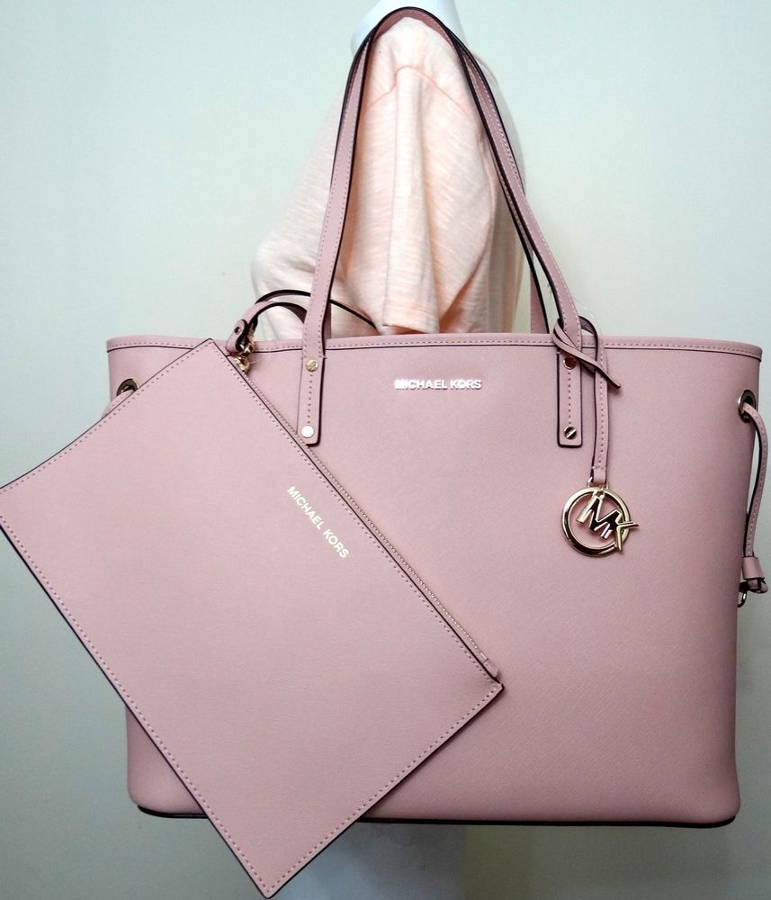 04140db53f982 Michael Kors Jet Set Travel Large Leather Drawstring Tote In Pastel Pink. (  NO DUST BAG FOR THIS STYLE). Open top with drawstring both side.