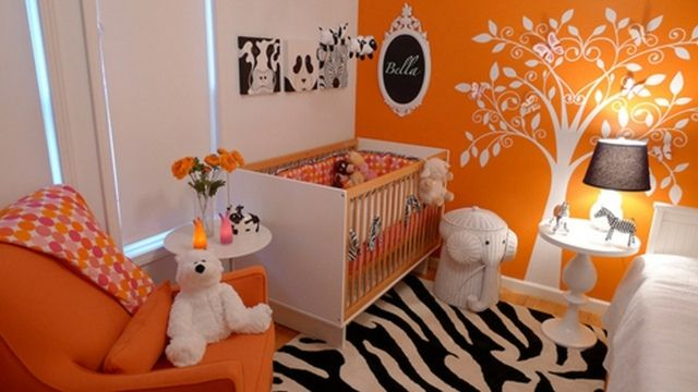 Beautiful orange nursery the bright orange is diluted with a zebra patterned floor rug